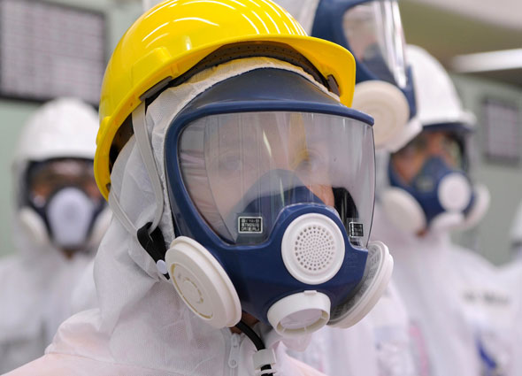U.S. Ambassador to Japan Caroline Kennedy wearing a yellow helmet and a mask inspects the central control room for the Unit 1 and Unit 2 reactors of the tsunami-crippled Fukushima Daiichi nuclear power plant last month. (Photo: AP /Toru Yamanaka)